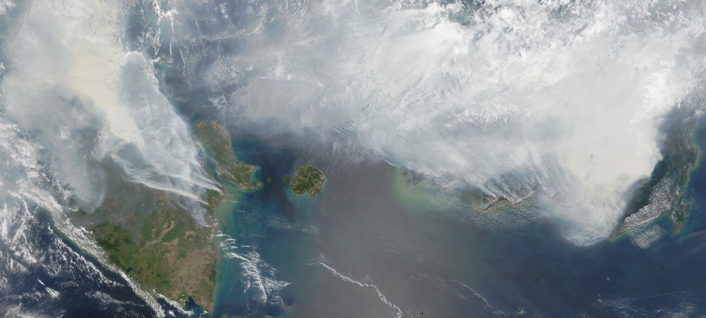 September 24 image from the Moderate Resolution Imaging Spectroradiometer (MODIS) on NASA's Terra satellite. Thick gray smoke from fires hovers over the islands of Sumatra (left) and Kalimantan (right) and has triggered air quality alerts and health warnings in Indonesia and neighboring countries. Visibility has plummeted.