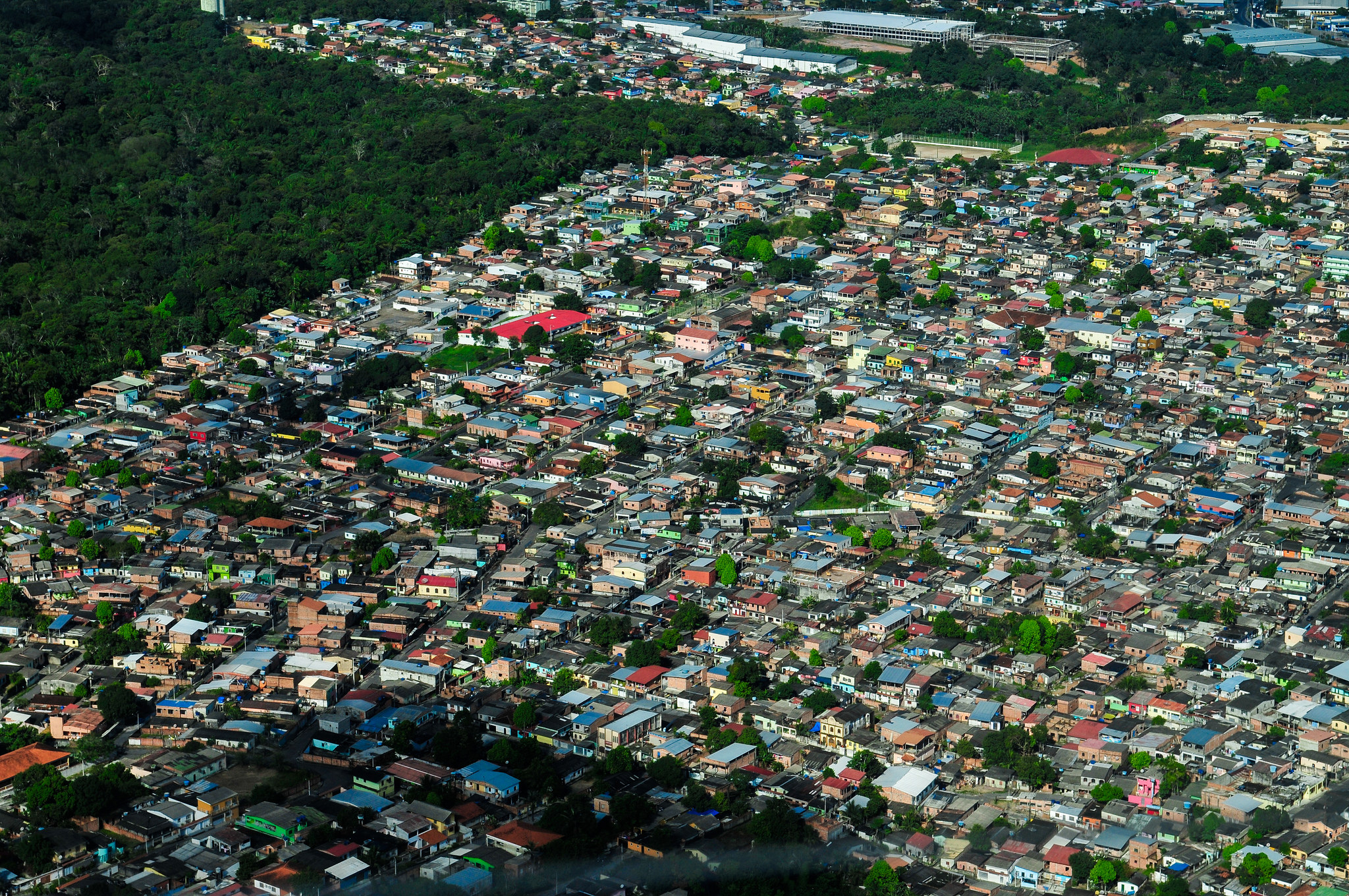Aerial view of Manaus, the capital of the Brazilian state of Amazonas, Brazil. Image shows dense development coming right up to the edge of the forest.